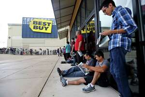 Shoppers wait in line outside Best Buy for the store to open on Gray Thursday Nov. 26, 2015.