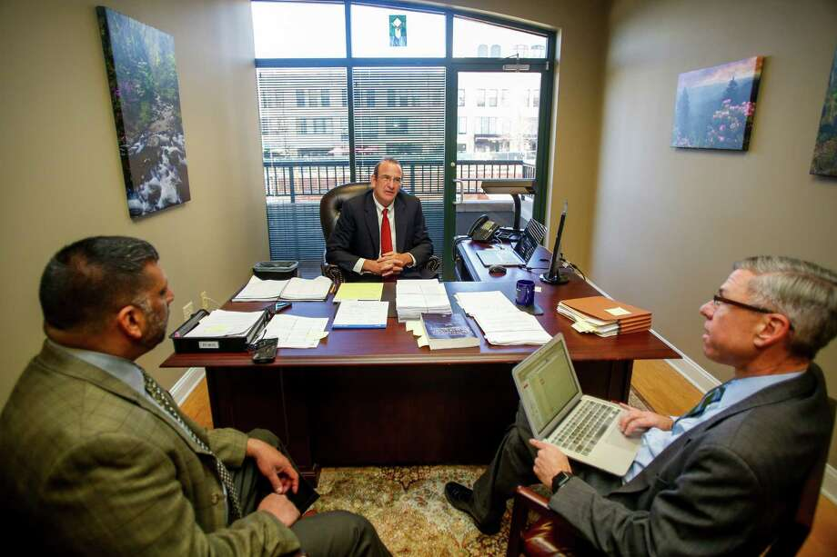 From left, David Wijewickrama, Fred Barbour and Scott Jones, attorneys representing North Carolina state troopers in a lawsuit over pay, discuss the case in their Asheville, N.C. office, Thursday, Nov. 19, 2015. State troopers suing North Carolina for millions of dollars in back pay say the state's broken promises have forced them into tough spots. It's not unusual for a trooper to have a second job and some are even on food stamps. (AP Photo/Nell Redmond) ORG XMIT: NCNR101 Photo: Nell Redmond / FR25171 AP