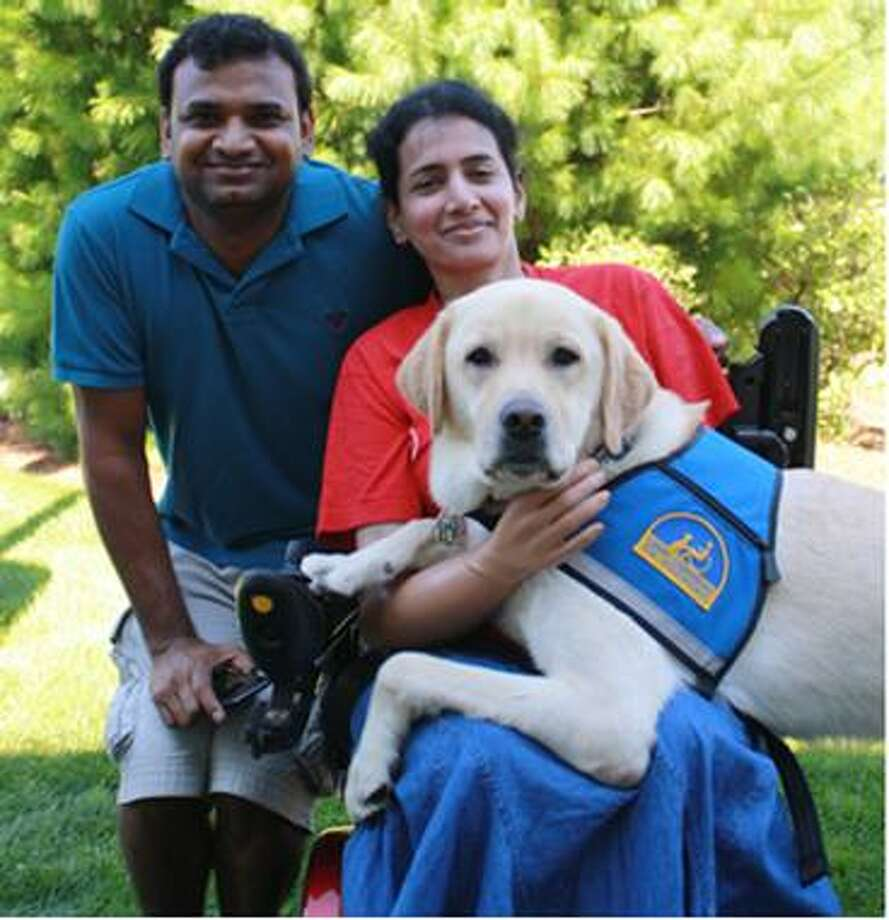 Anupama Malempati of Watervliet, with her husband Siva and her assistance dog, Nebraska. (Canine Companions photo)