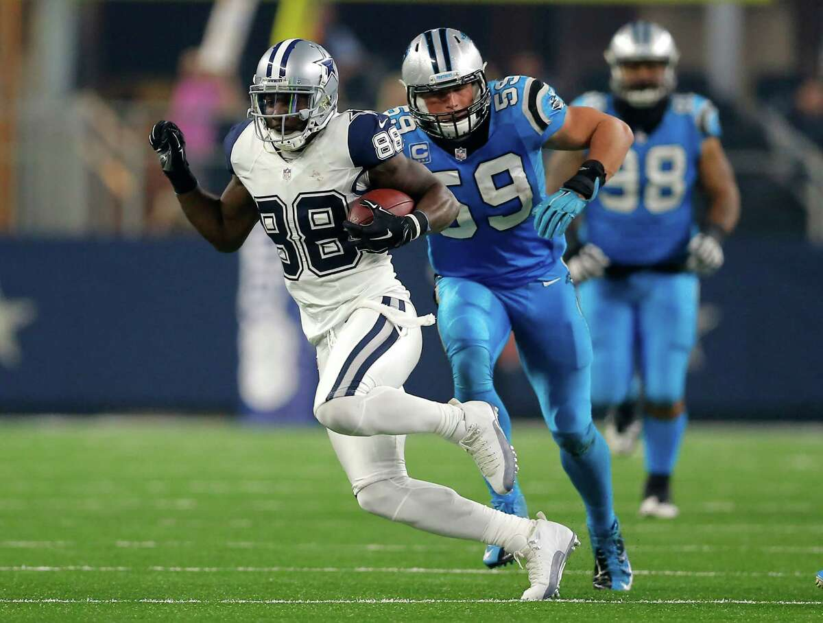 Dallas Cowboys' Dez Bryant (88) finds running room after making a catch as Carolina Panthers middle linebacker Luke Kuechly (59) gives chase during the second half of an NFL football game Thursday, Nov. 26, 2015, in Arlington, Texas. (AP Photo/Brandon Wade)