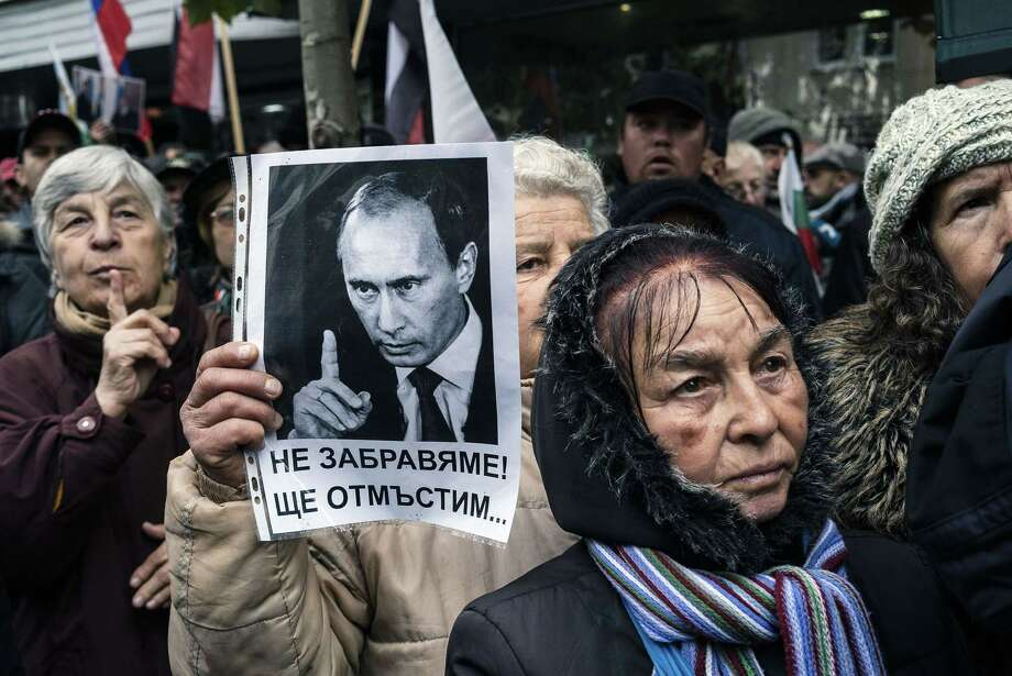 TOPSHOTS A woman, supporter of Bulgarian ultra-nationalist Ataka party, holds a picture of Russian president Vladimir Putin during a protest supporting Russia in front of the Turkish embassy in Sofia on November 26, 2015. Tensions have soared between Moscow and Ankara following the downing of the Russian jet on the Syrian border on November 24. Moscow has already warned its nationals against visiting Turkey and stepped up controls of Turkish agricultural imports.  AFP PHOTO / DIMITAR DILKOFFDIMITAR DILKOFF/AFP/Getty Images Photo: DIMITAR DILKOFF / AFP