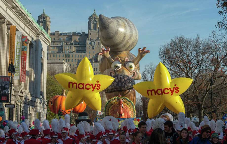 Performers stand in front of balloons at the start of the Macy's Thanksgiving Day Parade, Thursday Nov. 26, 2015, in New York.  (AP Photo/Bryan R. Smith) ORG XMIT: NYBS101 Photo: Bryan R. Smith / FRE171336 AP