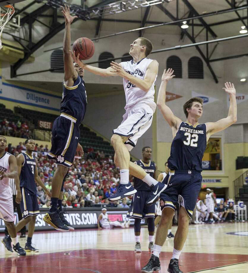 Monmouth guard Collin Stewart (30) drives to the basket as Notre Dame forward Bonzie Colson (35) and guard Steve Vasturia (32) defend during the first half of an NCAA college basketball game Thursday, Nov. 26, 2015, in Orlando, Fla. (AP Photo/Willie J. Allen Jr.)  ORG XMIT: FLWA132 Photo: Willie J. Allen, Jr. / FR170803 AP