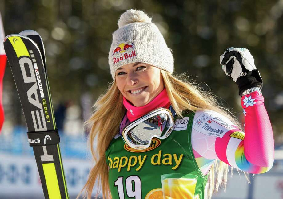 FILE - In this Dec. 7, 2014 file photo, Lindsey Vonn, of the United States, celebrates her second place finish in the women's World Cup Super-G ski race in Lake Louise, Alberta. Throughout the season, American teammates Vonn and Mikaela Shiffrin could very well be at the top of the overall standings. Might come down to the very end, too. No bitterness, they maintain. Just a robust rivalry. (Jeff McIntosh /The Canadian Press via AP, File) MANDATORY CREDIT ORG XMIT: NY152 Photo: Jeff McIntosh / The Canadian Press