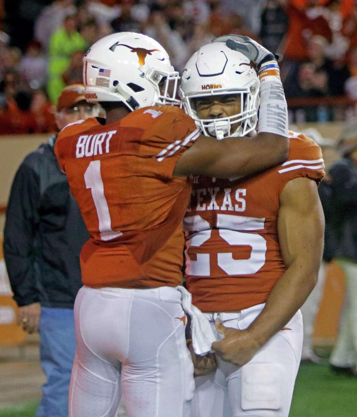Texas' Chris Warren III (25) is congratulated by John Burt (1) after scoring a touchdown during the second half of an NCAA college football game against Texas Tech, Thursday, Nov. 26, 2015, in Austin, Texas. Texas Tech won 48-45. (AP Photo/Michael Thomas)