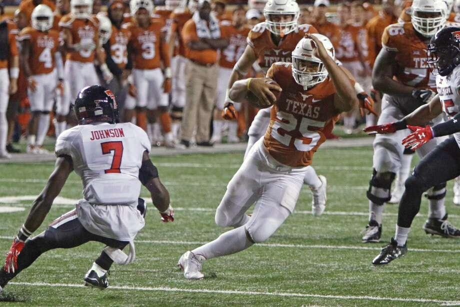 Texas running back Chris Warren III (25) runs for a touchdown as Texas Tech Jah'Shawn Johnson (7) defends during the second half of an NCAA college football game Thursday, Nov. 26, 2015, in Austin, Texas. Texas Tech won 48-45. (AP Photo/Michael Thomas) Photo: Michael Thomas, Associated Press / FR65778 AP