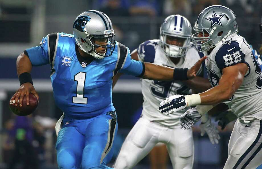 ARLINGTON, TX - NOVEMBER 26: Cam Newton #1 of the Carolina Panthers is chased by Tyrone Crawford #98 of the Dallas Cowboys in the second half at AT&T Stadium on November 26, 2015 in Arlington, Texas. (Photo by Tom Pennington/Getty Images) ORG XMIT: 582310697 Photo: Tom Pennington / 2015 Getty Images