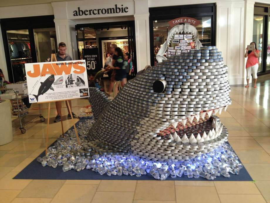Mdn Architects' Jaws replica, made of 6,700 cans of tuna, won first place in the 10th annual Canstruction design competition at North Star Mall in September. Mdn employees reconstructed the shark in the San Antonio Food Bank lobby, where it will sit for the next year. Photo: Courtesy Photo