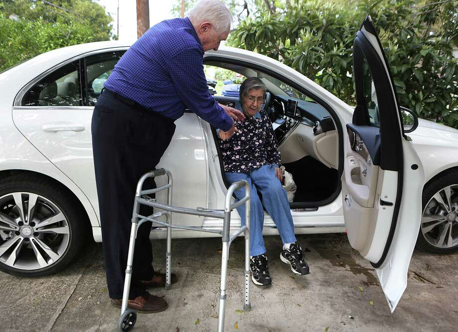 """Dick Busacker, a driver with """"Call A Ride for Seniors,"""" helps Ana Jeffery, 87, get in his car on the way to a doctor's appointment on Nov. 11. Photo: Bob Owen /San Antonio Express-News / San Antonio Express-News"""