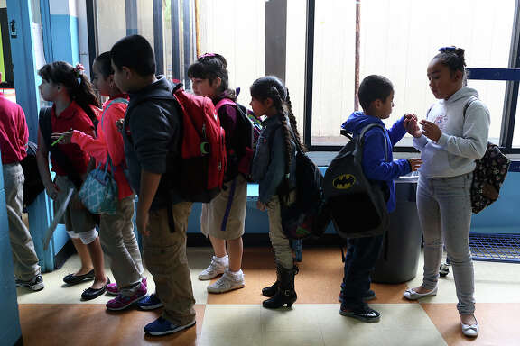 Children line up for after-school tutoring at the Boys & Girls Clubs of San Antonio Calderon Branch on Nov. 9, 2015.