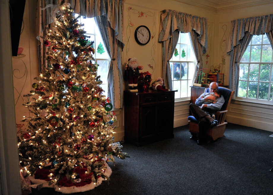 Respite Care of San Antonio's Bert Pfiester gets in a late-morning rock with one of the children who attend daily. Photo: Express-News File Photo