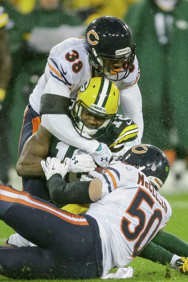 GREEN BAY, WI - NOVEMBER 26:   Randall Cobb #18 of the Green Bay Packers is hit by Adrian Amos #38 and  Shea McClellin #50 of the Chicago Bears in the first quarter at Lambeau Field on November 26, 2015 in Green Bay, Wisconsin.  (Photo by Mike McGinnis/Getty Images) ORG XMIT: 582367699 Photo: Mike McGinnis / 2015 Getty Images