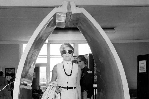 Mrs. Donald Pritzker walks through a metal detector as part of a security check at San Francisco International Airport in 1973.