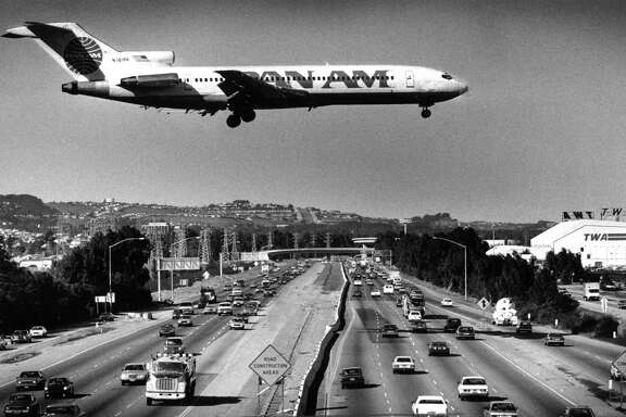 Planes land and take off at runways rarely used because of the wind at San Francisco International Airport in 1987.