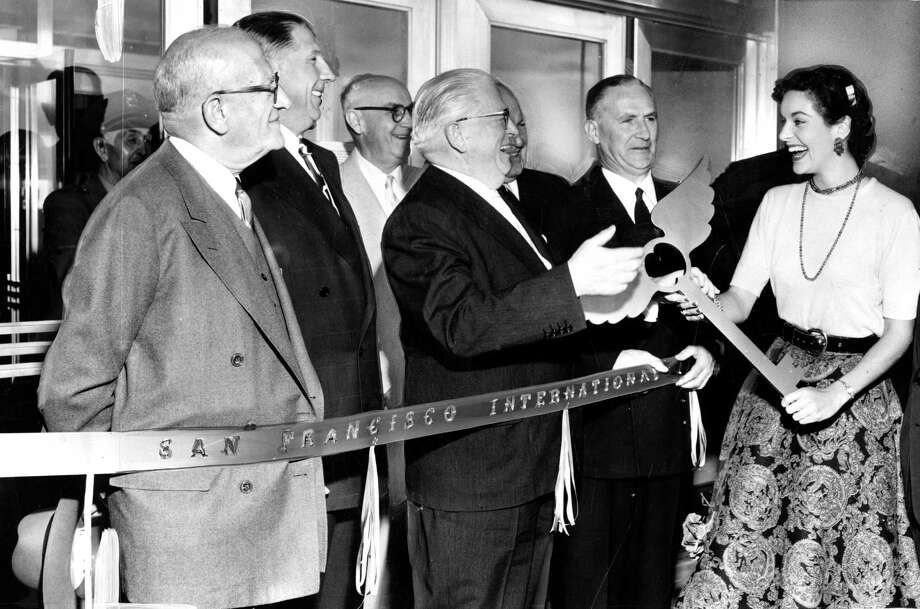 Lee Ann Meriwether presents gold key to Mayor Elmer Robinson at the opening celebration of the new  terminal at  San Francisco International Airport in August of 1954. Photo: Gordon Peters / The Chronicle / ONLINE_YES