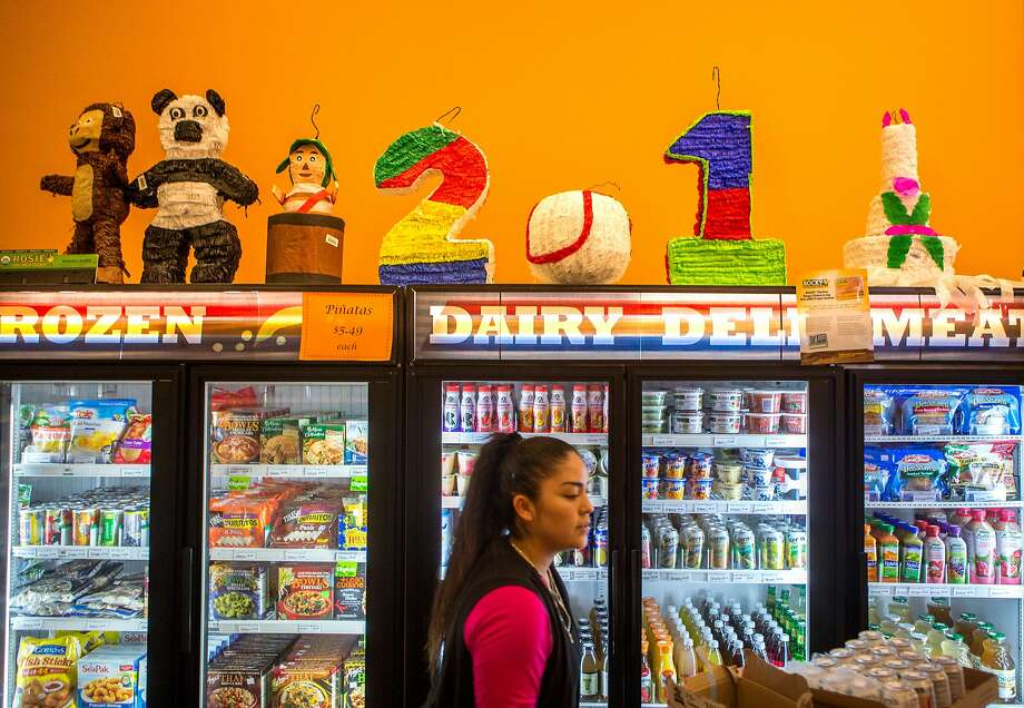 Tina Guerrero stocks beverages at the Value Market, a store operated by the Redwood Empire Food Bank, on Wednesday, Nov. 25, 2015 in Santa Rosa, Calif. Photo: Nathaniel Y. Downes, The Chronicle