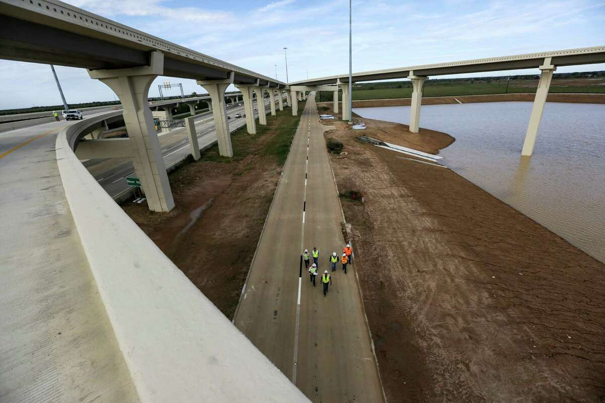 Crews do a final walkthrough of a feeder road under the Grand Parkway near U.S. 290 on Nov. 12, northwest of Houston.