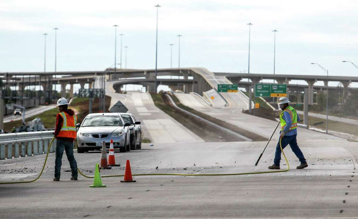 Crews clean off a bridge on a portions of the Grand Parkway near the intersection with U.S. 290on Nov. 12. The section of the Grand Parkway from U.S. 290 to Interstate 45 is expected to open the first week of February.