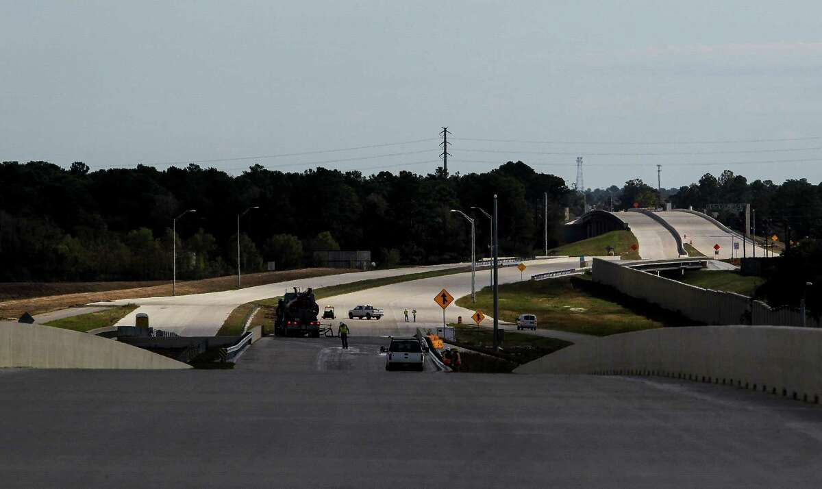 Crews work on a portion of the Grand Parkway on Nov. 12. The parkway, expected to open next year, stretches from U.S. 290 north and east to U.S. 59.