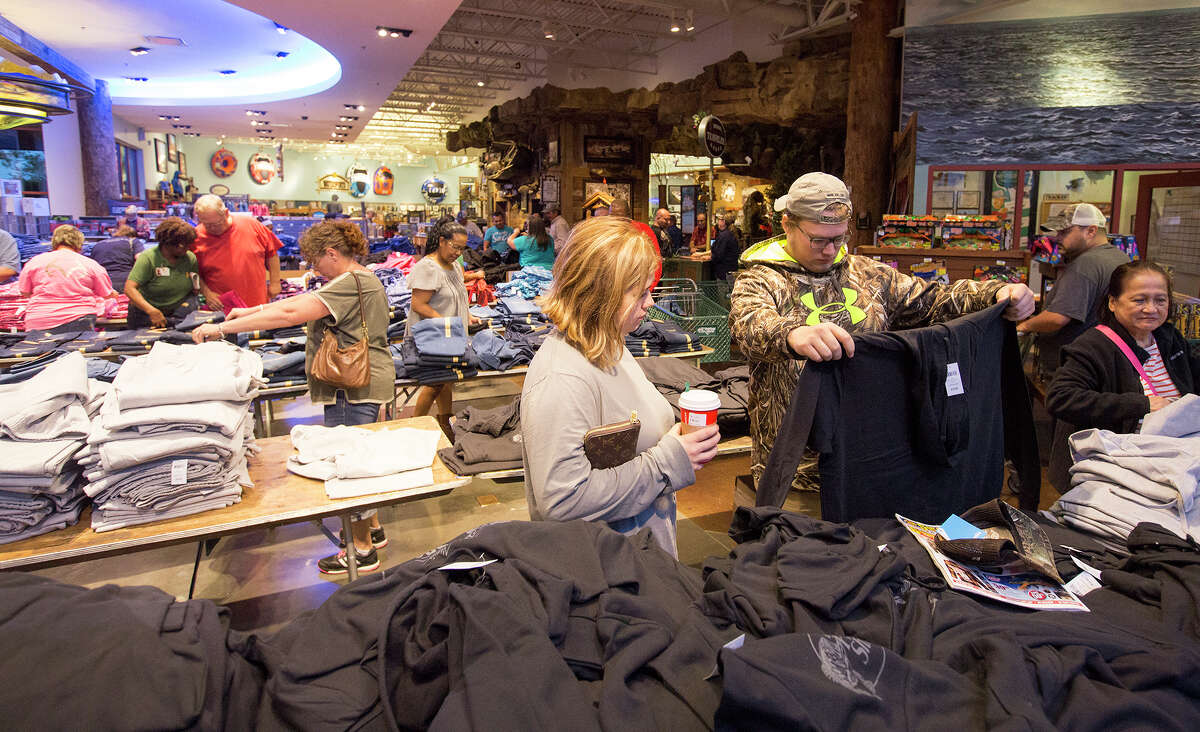 Makayla Pardon, left, and Jake Schrock, right, shop during Black Friday at Bass Pro Shops, Friday, Nov. 27, 2015, in Pearland.