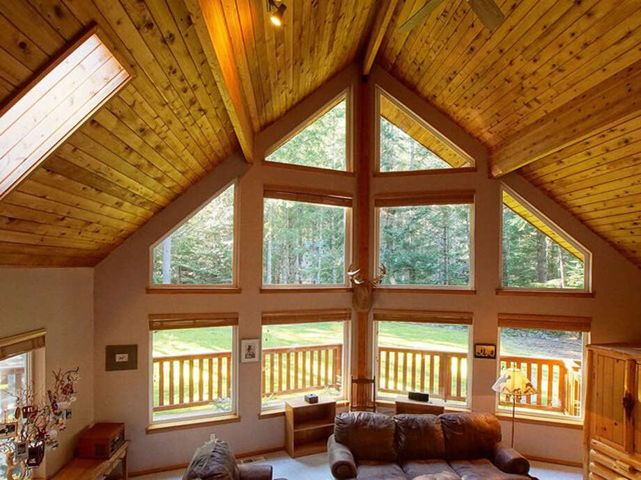 There's that nip in the air. It's December already. So let's talk ski chalets. This week we offer you a look at two in Greenwater, the Pierce County town on the edge of Mount Rainier National Park and a close drive to Crystal Mountain. The first property is at 17215 Alpine Drive E. The full listing is here. Photo: Dana Kerr