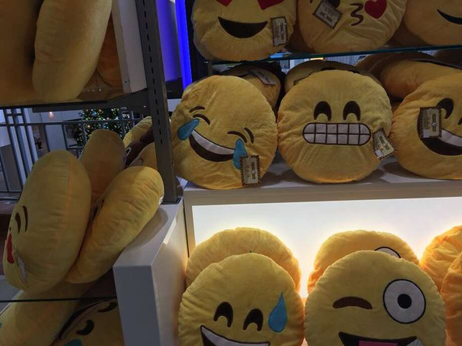 Emoji pillows are among the items for sale on Black Friday, Nov. 27, 2015, at Colonie Center in Colonie. (Lindsay Ellis/Times Union)