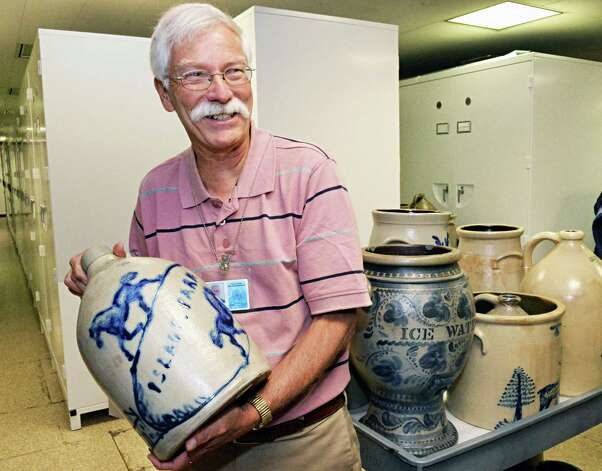 Historian emeritus John Scherer with a 2 gallon jug commemorating Island Park race track in Menands from the Weitsman Stoneware Collection, donated by scrap metal mogul Adam Weitsman at the NYS Museum Thursday June 5, 2014, in Albany, NY.  (John Carl D'Annibale / Times Union) Photo: John Carl D'Annibale / 00027193A