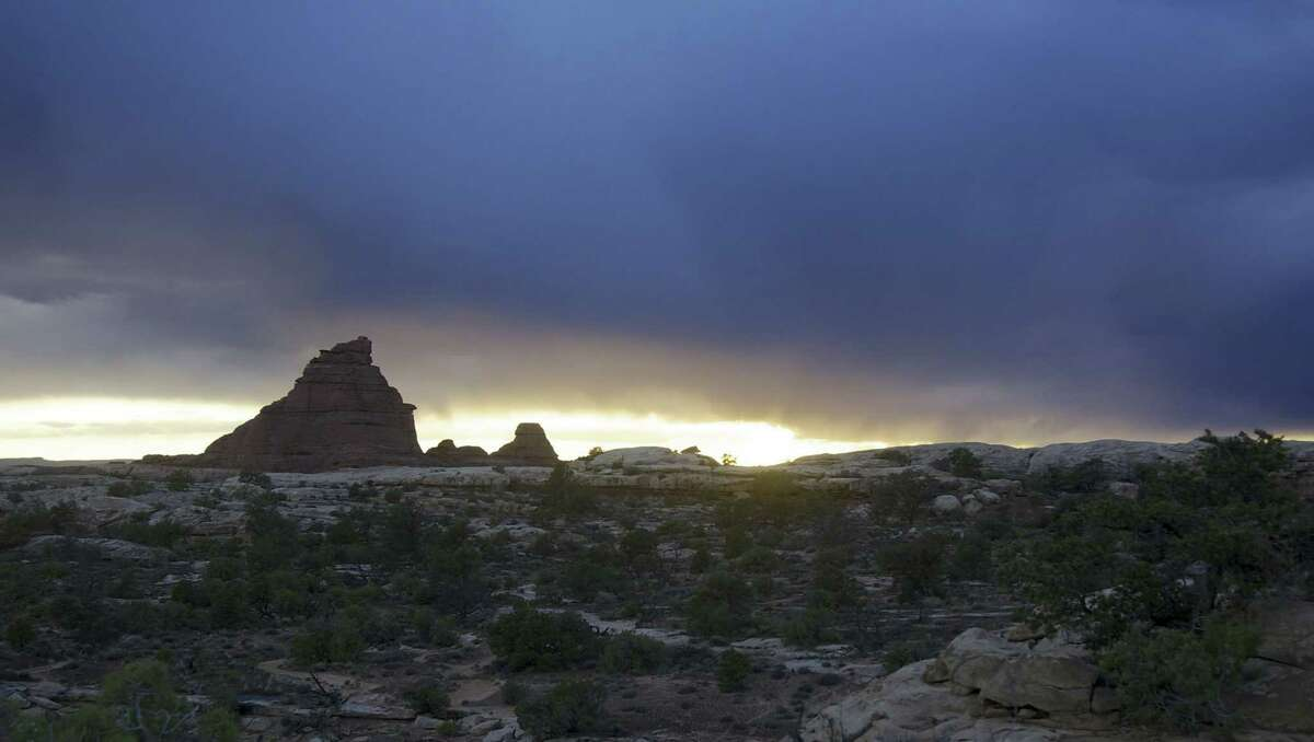A spring storm darkens the skies and makes travel more difficult in Canyonlands, which is near Moab and Arches National Park. (Brad Branan/Sacramento Bee/TNS) ORG XMIT: 1176465