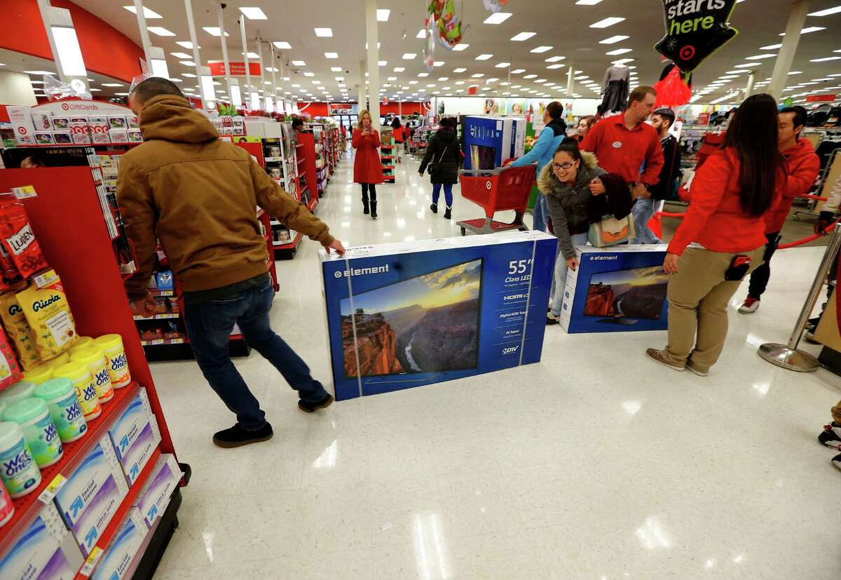 Guests take advantage of the electronics doorbusters during Target's Black Friday sales Thursday, Nov. 26, 2015 in Jersey City, N.J. (Noah K. Murray/AP Images for Target)