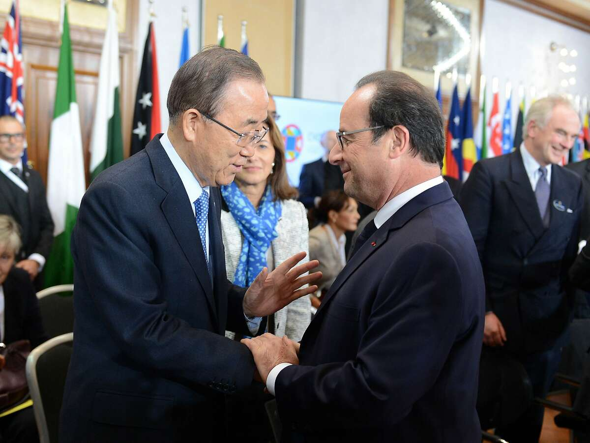 United Nations Secretary General Ban Ki-moon greets French President Francois Hollande, at the Climate Change special session held during CHOGM (Commonwealth heads of Government meeting), at the Raddison Golden Sands Hotel, Ghajn Tuffieha, Malta, Friday, November, 27 2015 ( AP Photo/Rene Rossignaud)