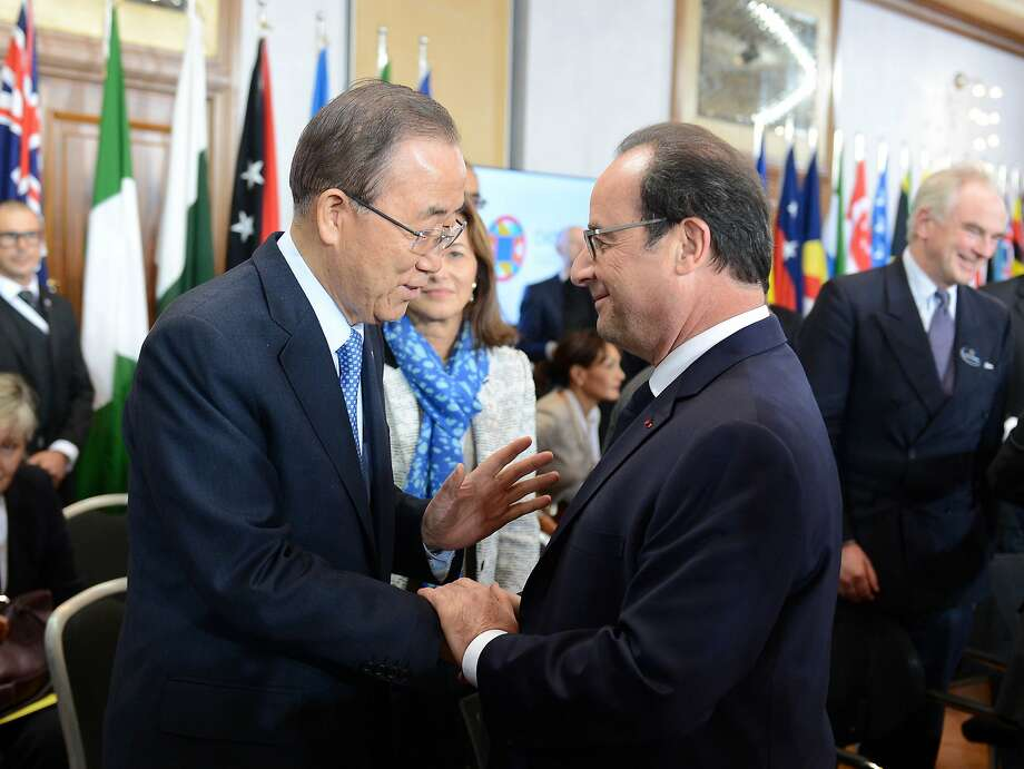 U.N. Secretary-General Ban Ki-moon (left) welcomes French President François Hollande on Friday in Malta during a ceremony before the Paris special session on climate change. Photo: Rene Rossignaud, Associated Press