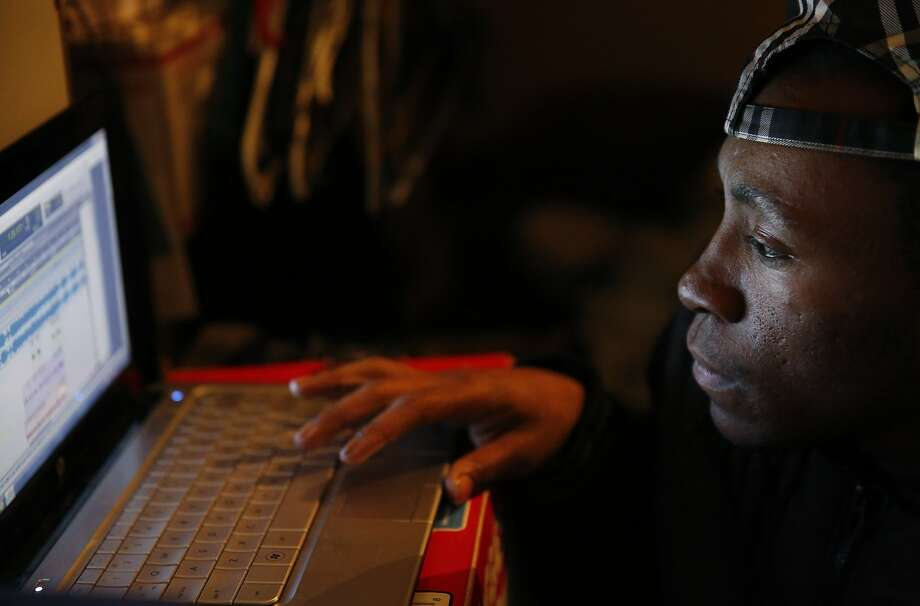 Treyvon Coulter, 22, works on a song in his East Oakland home. Photo: Leah Millis, The Chronicle