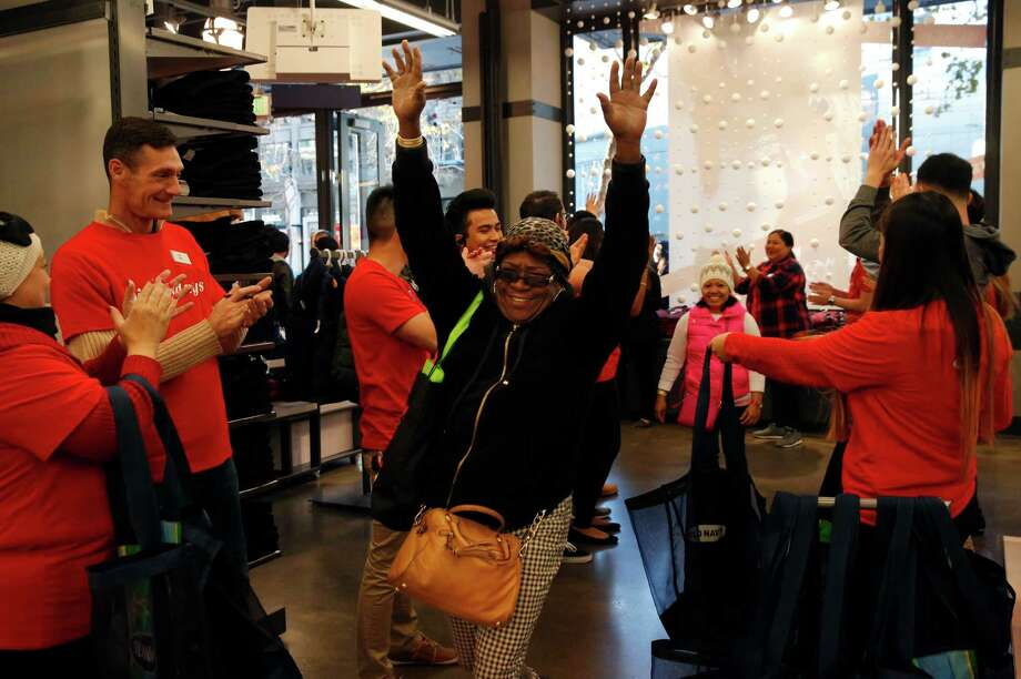 Tasha Clark is cheered at Old Navy in San Francisco Thursday. Photo: Leah Millis / Leah Millis / The Chronicle / ONLINE_YES