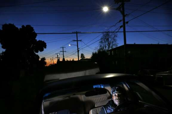 Treyvon Coulter, 22, pictured in his car outside of his East Oakland home Nov. 25, 2015 in Oakland, Calif.  In the last few years since Coulter has been driving, he says he has been pulled over about 10 times.