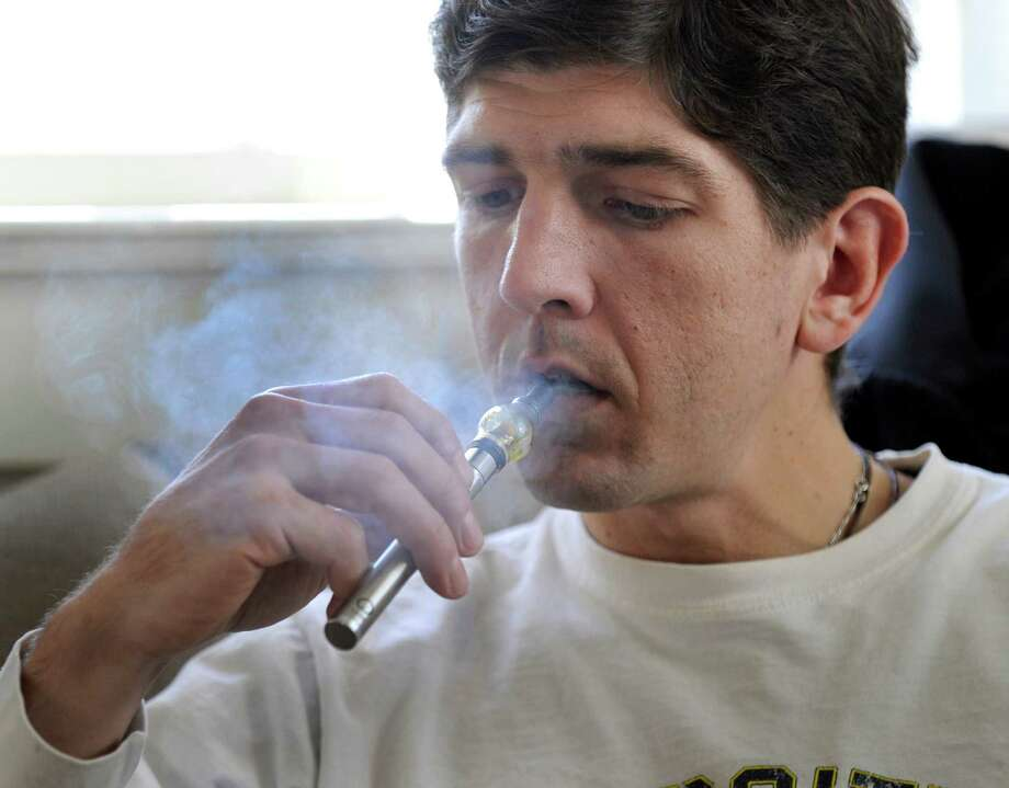 Brian Tomasulo, a Newtown resident who has brain cancer, has been using medical marijuana from the Compassionate Care Center in Bethel. Photo: Carol Kaliff / Hearst Connecticut Media / The News-Times