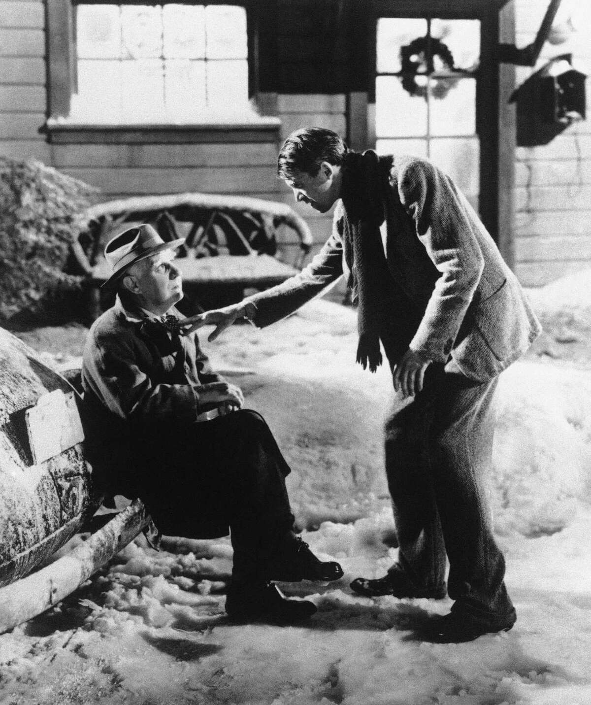"""In this undated file photo, Henry Travers as Clarence the Angel, left, and James Stewart as George Bailey are seen in a scene from the 1946 film """"It's A Wonderful Life."""" Folks in Seneca Falls, N.Y., think Bailey's make-believe hometown, Bedford Falls in the movie, was heavily inspired by their upstate town. This cannot be proven, and director Frank Capra never confirmed such a connection, but that hasn't stopped locals in Seneca Falls from celebrating the beloved movie every December. (AP Photo, File) ORG XMIT: NYR201"""