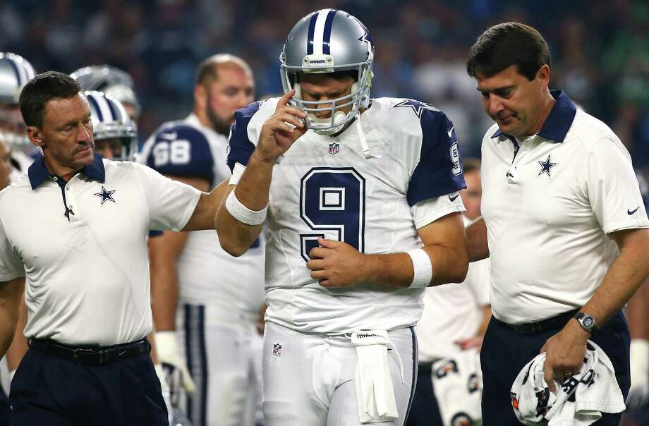 Tony Romo of the Dallas Cowboys is looked after by team trainers after being sacked by the Carolina Panthers in the third quarter at AT&T Stadium on Nov. 26, 2015 in Arlington. Photo: Tom Pennington /Getty Images / 2015 Getty Images