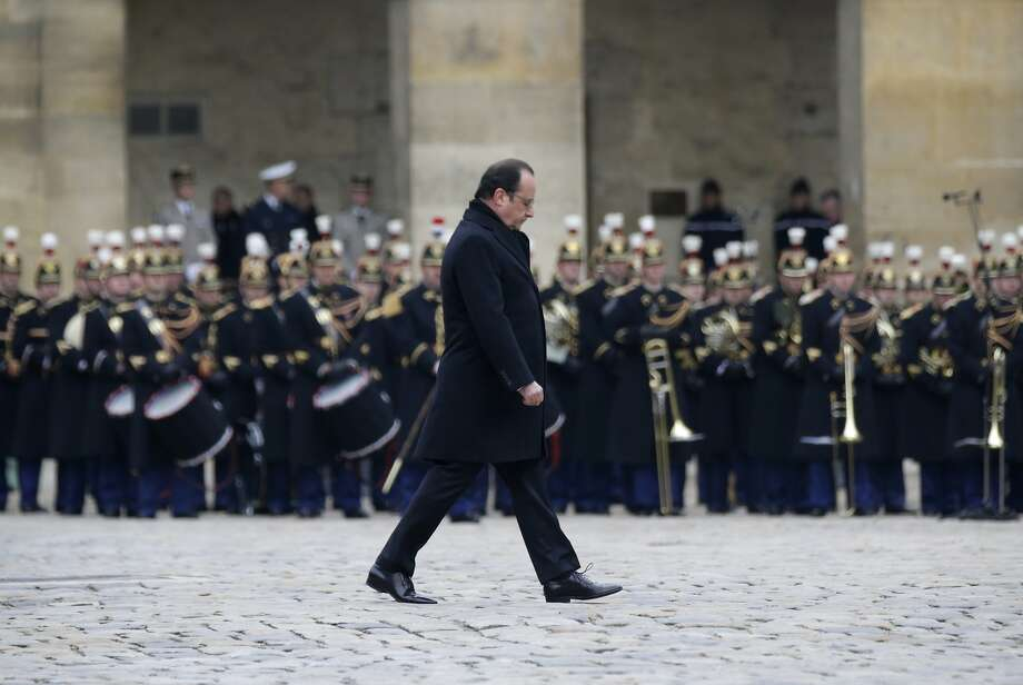 President Francois Hollande attends a ceremony to honor the 130 victims killed two weeks ago. Photo: Philippe Wojazer, Associated Press