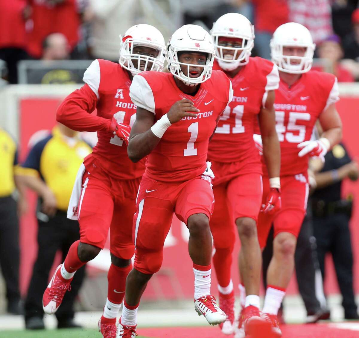 Houston Cougars quarterback Greg Ward Jr. (1) is congratulated by Houston Cougars teammates after scoring a second quarter touchdown against the Navy Midshipmen a NCAA college football game at TDECU Stadium Friday, Nov. 27, 2015, in Houston, Texas.