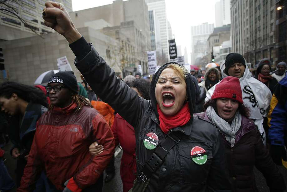 Demonstrators protest the shooting of Laquan McDonald along Chicago's Magnificent Mile. Photo: Joshua Lott, Getty Images
