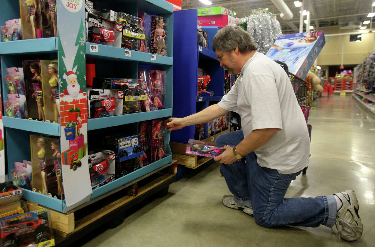 Robert Perry shops for Barbie dolls on Black Friday November 27, 2015 at the H-E-B at Loop 1604 and Blanco road. Perry was looking for a present for his granddaughter.