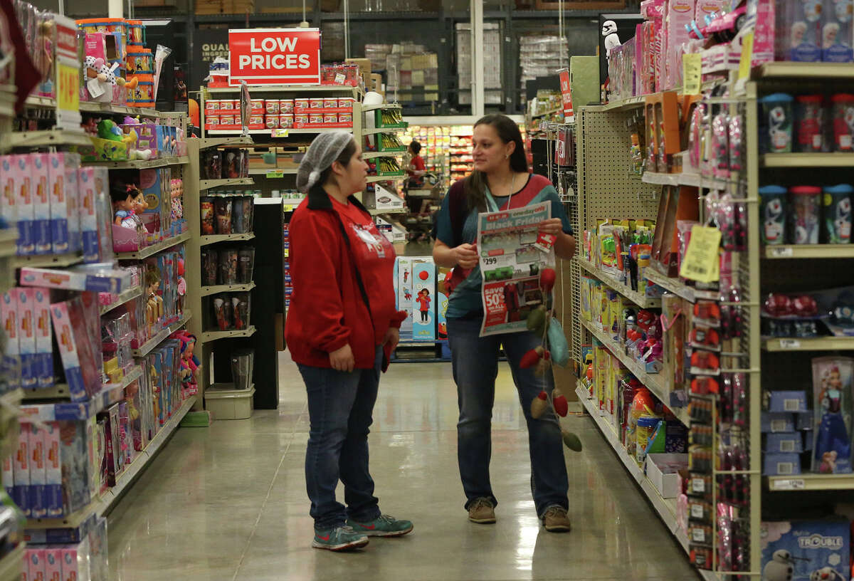 Employee Laura Montelongo (left) speaks with customer Misty Leija (right) on Black Friday November 27, 2015 at the H-E-B store located at Loop 1604 and Blanco road. Leija was looking for a Nerf gun for her nephew.