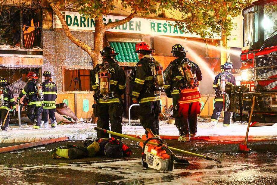 Berkeley firefighters extinguish the remaining embers of a fire at the Mandarin Garden Restaurant on Shattuck Ave. in Berkeley, Calif on Friday, November 27, 2015. Photo: Zach Owens, Special To The Chronicle