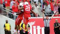 Houston Cougars quarterback Greg Ward Jr. (1) is congratulated by Houston Cougars wide receiver Chance Allen (21) after scoring a second quarter touchdown against the Navy Midshipmen a NCAA college football game at TDECU Stadium Friday, Nov. 27, 2015, in Houston, Texas.