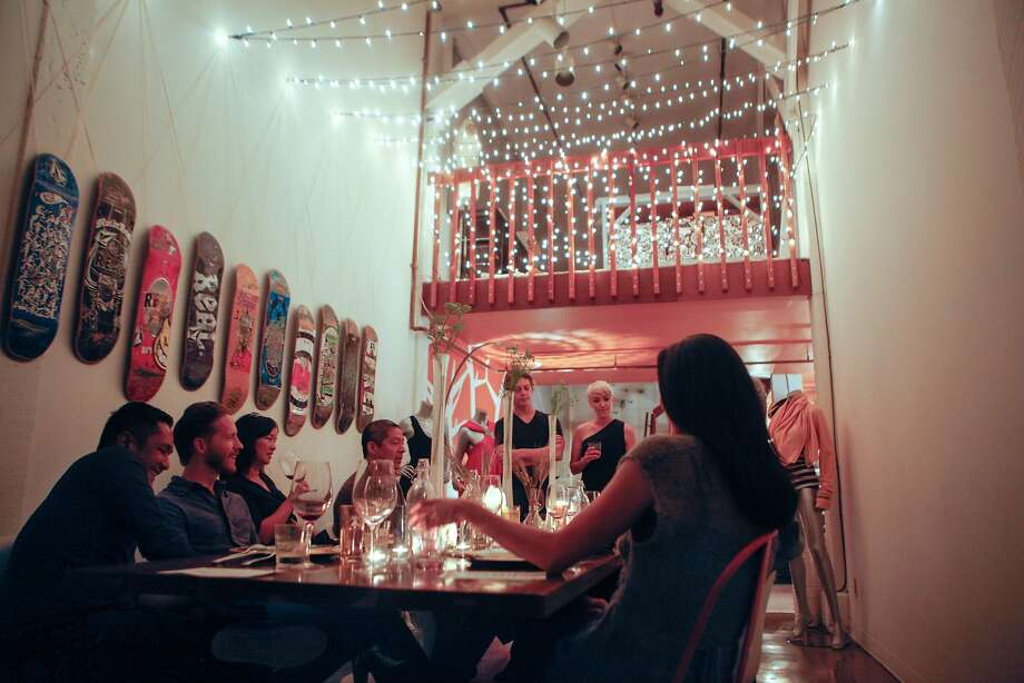 Dan and Jeanne, center, answering questions from their guests at the end of the meal about the food, their travels, and how they were inspired to start the Hearsay Supper Club on November 21, 2015. Photo: Franchon Smith, The Chronicle