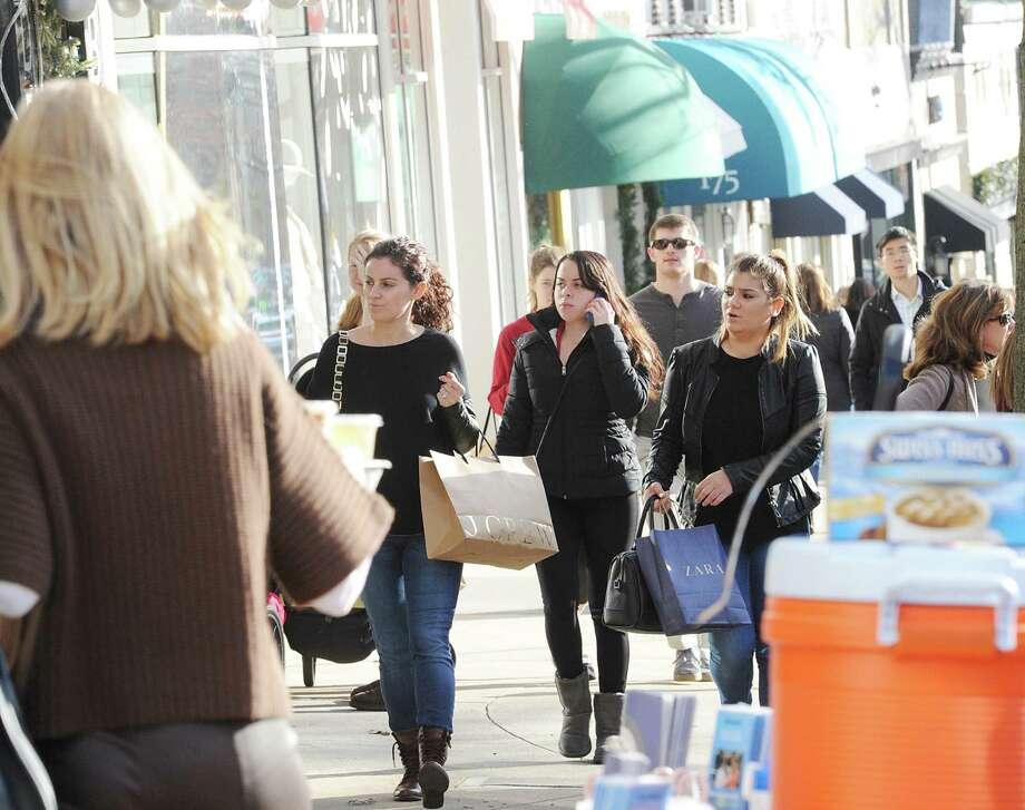 A crowded sidewalk during Black Friday shopping on Greenwich Avenue, Greenwich, Conn., Friday, Nov. 27, 2015. Photo: Bob Luckey Jr., Hearst Connecticut Media / Greenwich Time