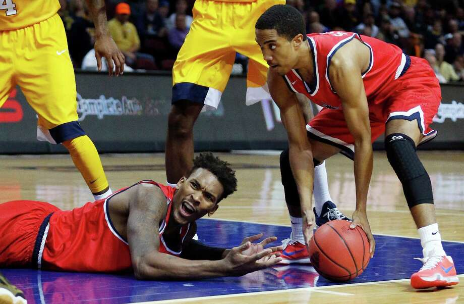 Richmond forward Terry Allen, reacts on the floor after a play as teammate ShawnDre' Jones grabs the ball during the second half of an NCAA college basketball game against West Virginia on Thursday, Nov. 26, 2015, in Las Vegas. West Virginia won 67-59. (AP Photo/John Locher) Photo: John Locher / Associated Press / AP