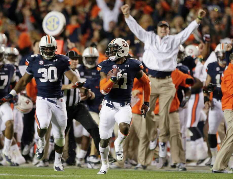 "Niners cornerback Chris Davis in the midst of the ""Kick Six"" during his senior season at Auburn in 2013. Photo: Dave Martin / Associated Press / AP"