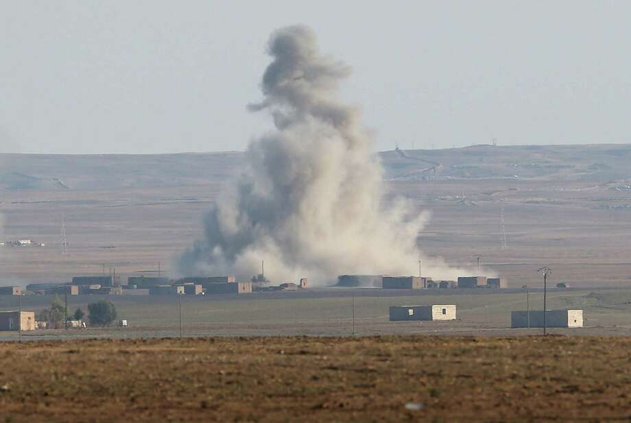 An airstrike by a U.S. led coaltion warplane explodes on an ISIL position on Nov. 10 near the town of Hole, Rojava, Syria. A reader advocates that the president order boots on the ground to go along with the air attacks. Photo: John Moore / / 2015 Getty Images