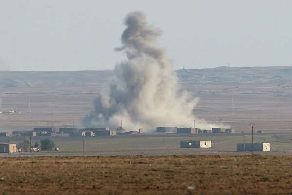 An airstrike by a U.S. led coaltion warplane explodes on an ISIL position on Nov. 10 near the town of Hole, Rojava, Syria. A reader advocates that the president order boots on the ground to go along with the air attacks.
